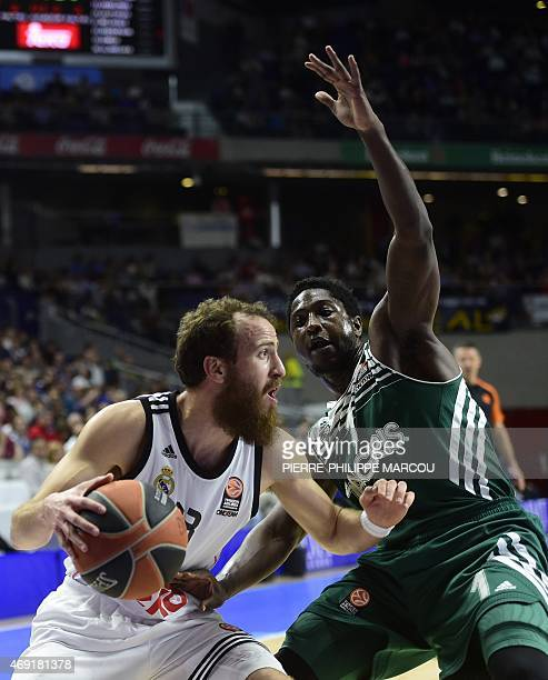 Real Madrid's guard Sergio Rodriguez vies with Zalgiris Kaunas' US guard Will Cherry during the Euroleague group E Top 16 round 14 basketball match...