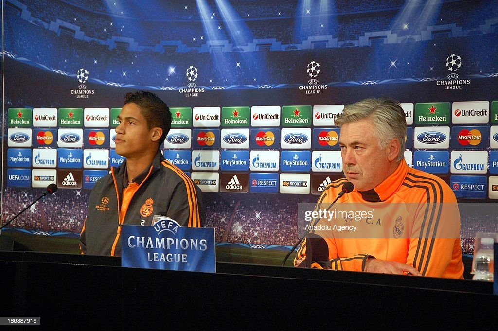 Real Madrid's head coach Carlo Ancelotti (R) and Raphael Varane (L) hold a press conference at Juventus Stadium on November 4, 2013 in Turin, Italy. Juventus will face Real Madrid in a UEFA Champions League Group B soccer match at Juventus Stadium on November 5.