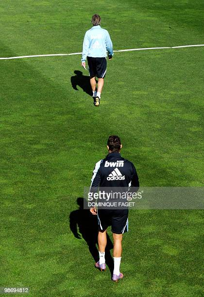 Real Madrid's head coach Manuel Pellegrini and and Portuguese forward Cristiano Ronaldo arrive for a training session in Madrid on April 27 2010 AFP...