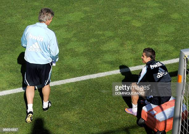 Real Madrid's Head coach Manuel Pellegrini looks at Portuguese forward Cristiano Ronaldo as he arrives for a training session in Madrid on April 27...