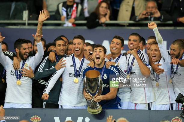 Real Madrid's Isco Angel di Maria Sergio Ramos Iker Casillas Cristiano Ronaldo Pepe Luka Modric and Karim Benzema celebrate after winning the UEFA...