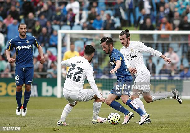 Real Madrid's Isco Gareth Bale and Pablo Sarabia of Getafe in action during the Spanish La Liga match between Real Madrid and Getafe at Coliseum...