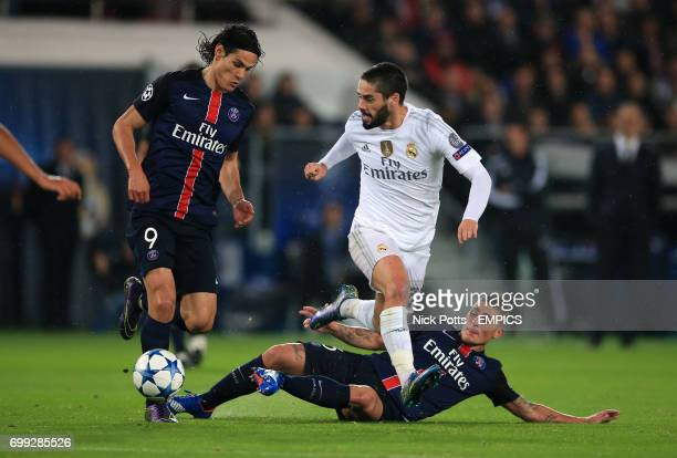Real Madrid's Isco jumps the tackles from Paris SaintGermain's Edinson Cavani and Marco Verratti