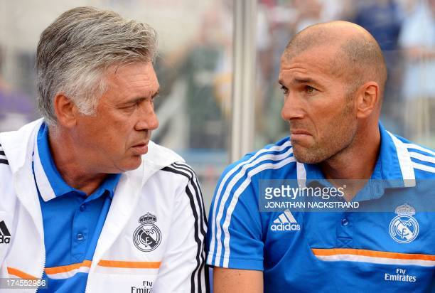 Real Madrid's Italian coach Carlo Ancelotti and his assistant French Zinedine Zidane is pictured prior a friendly football match between PSG and Real...