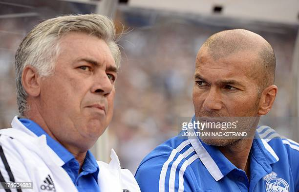 Real Madrid's Italian coach Carlo Ancelotti and his assistant French Zinedine Zidane are pictured prior a friendly football match between PSG and...