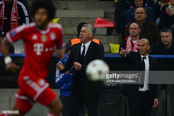 Real Madrid's Italian coach Carlo Ancelotti and Real Madrid's assistant manager Zinedine Zidane react as Bayern Munich's Brazilian defender Dante...