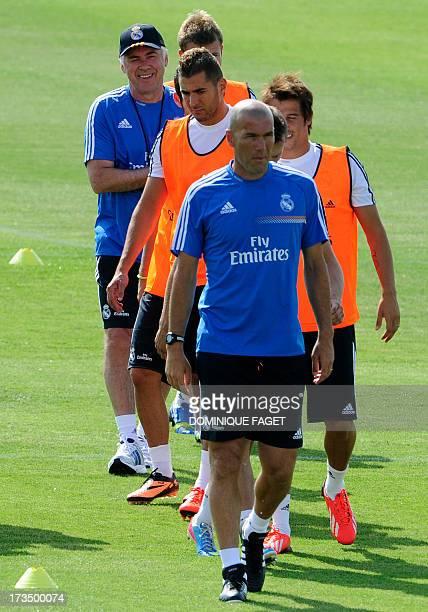 Real Madrid's Italian coach Carlo Ancelotti Real Madrid's French assistant coach Zinedine Zidane and Real Madrid's French forward Karim Benzema take...