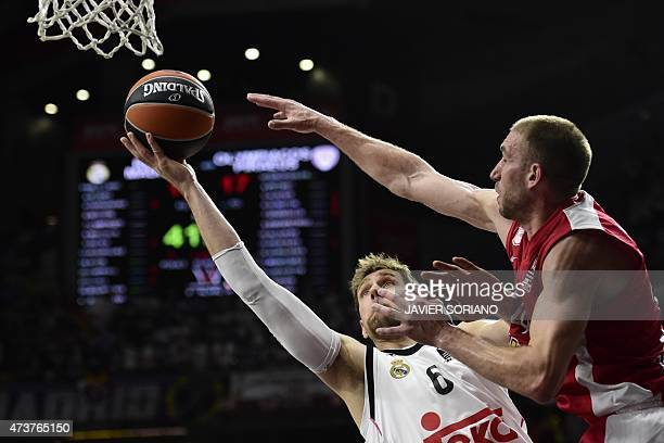 Real Madrid's Italian forward Andres Nocioni vies with Olympiacos Piraeus' US guard Matthew Lojeski during the Euroleague Final Four basketball match...