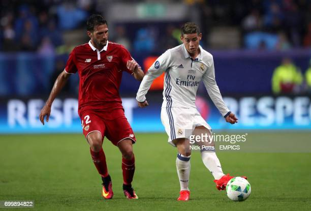 Real Madrid's James Rodriguez and Sevilla's Franco Vazquez battle for the ball