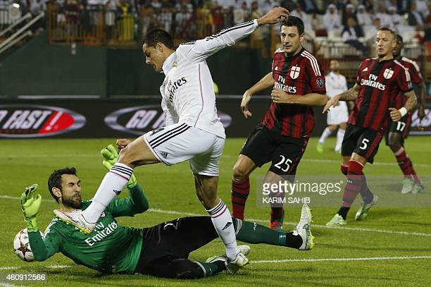 Real Madrid's Javier Hernandez tries vies to score a goal as AC Milan's goalkeeper Diego Lopez defends the goal and defenders Daniele Bonera and...