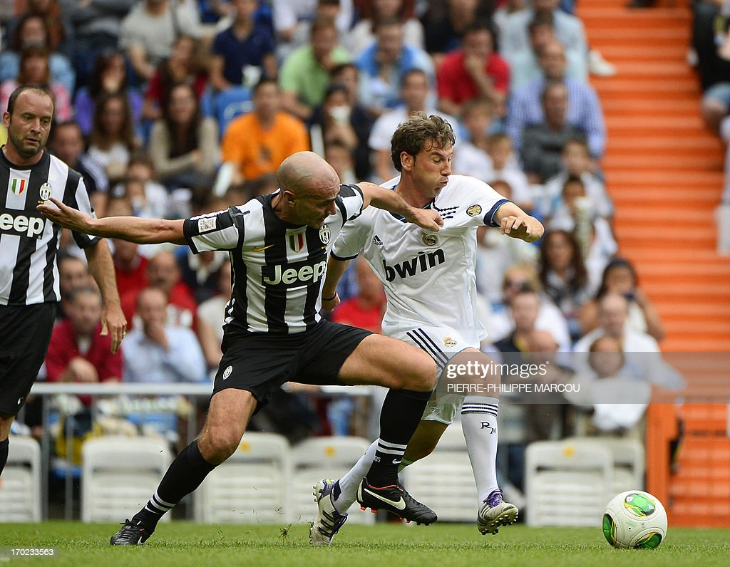 Real Madrid's Jesus Enrique Velasco (R) vies with Juventus veteran's Paolo Montero during the Corazon Classic Match 2013 - Veracruz charity football match Real Madrid Legends vs Juventus Turin Veterans at the Santiago Bernabeu stadium in Madrid on June 9, 2013.