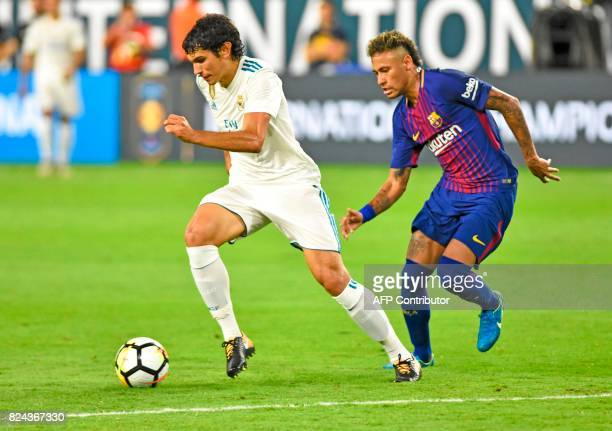 Real Madrid's Jesus Vallejo vies for the ball against Barcelona's Neymar during the second half of the International Champions Cup soccer friendly at...