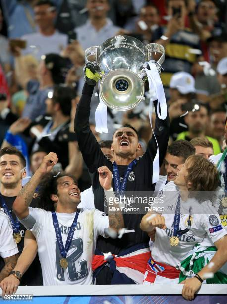 Real Madrid's Keylor Navas celebrates with the trophy