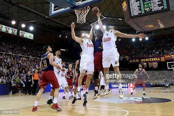 Real Madrid's Lithuanian forward Jonas Maciulis and Real Madrid's forward Felipe Reyes vies with Barcelona's US guard Joey Dorsey during the...