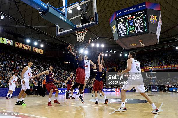 Real Madrid's Lithuanian forward Jonas Maciulis vies with Barcelona's US guard Joey Dorsey during the Euroleague top 16 group F basketball match FC...