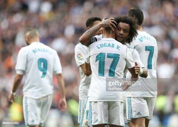 Real Madrid's Lucas Vazquez and Marcelo celebrate during the Spanish league football match between Real Madrid and Sevilla at the Santiago Bernabeu...
