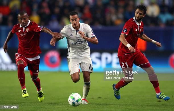 Real Madrid's Lucas Vazquez and Sevilla's Mariano and Nicolas Pareja