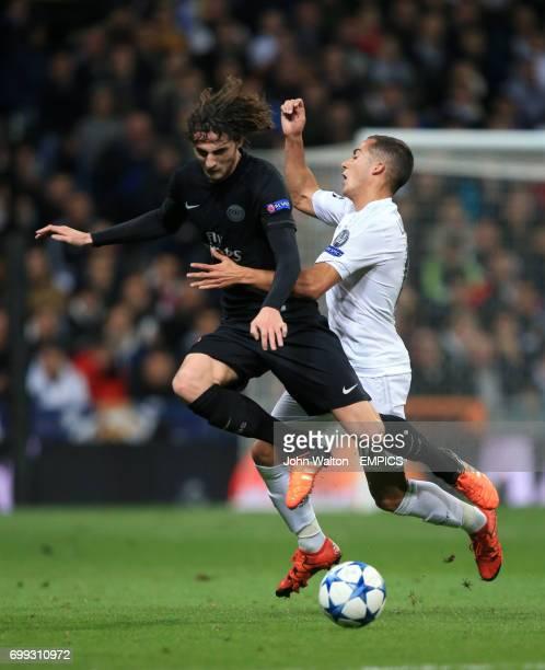 Real Madrid's Lucas Vazquez battles for possession of the ball with Paris SaintGermain Adrien Rabiot