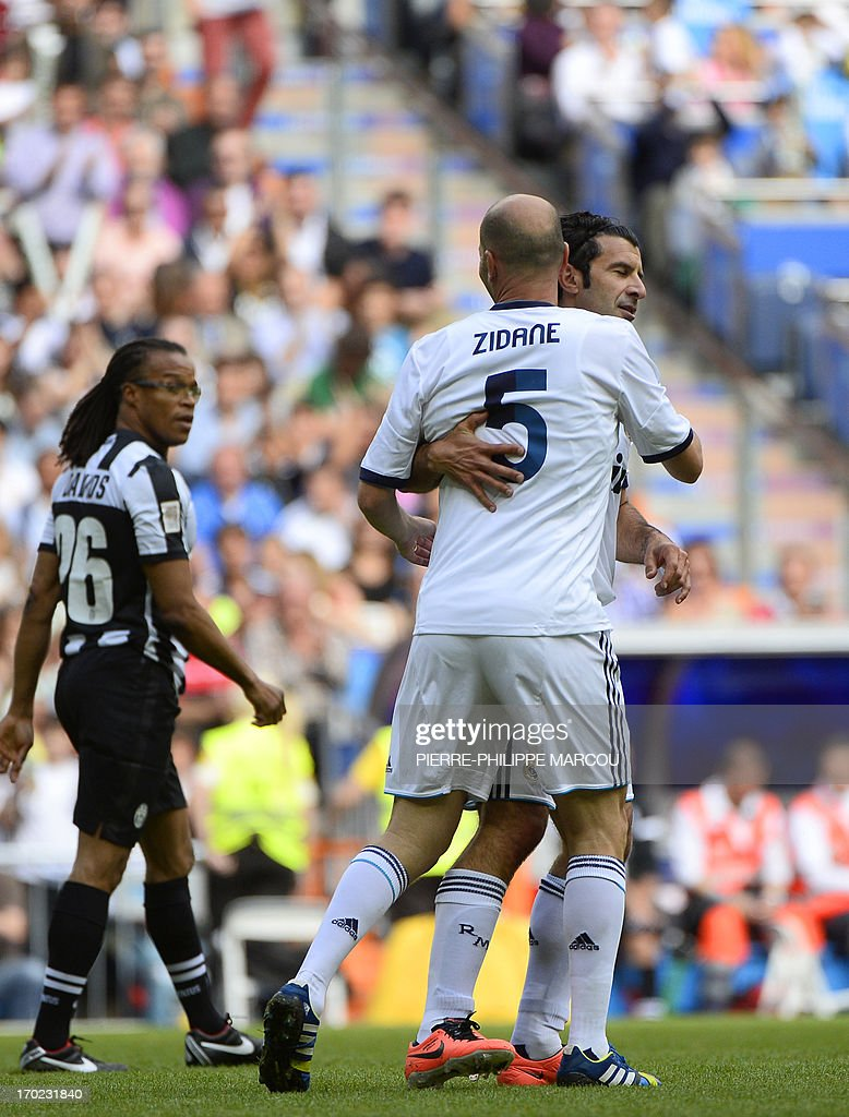 Real Madrid's Luis Figo (R) celebrates with Zinedine Zidane after scoring during the Corazon Classic Match 2013 - Veracruz charity football match Real Madrid Legends vs Juventus Turin Veterans at the Santiago Bernabeu stadium in Madrid on June 9, 2013.