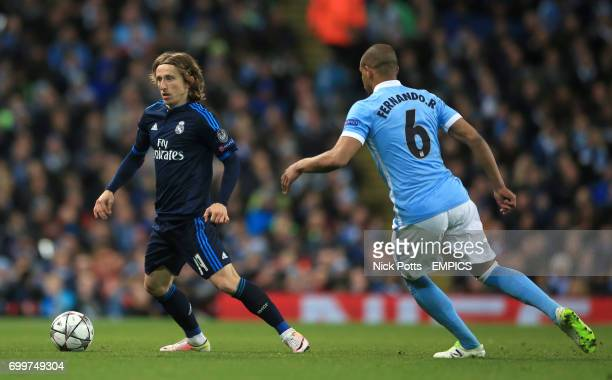 Real Madrid's Luka Modric and Manchester City's Fernando in ation