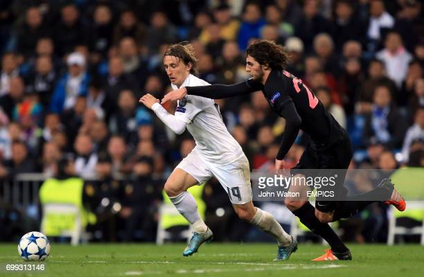 Real Madrid's Luka Modric and Paris SaintGermain's Adrien Rabiot battle for the ball