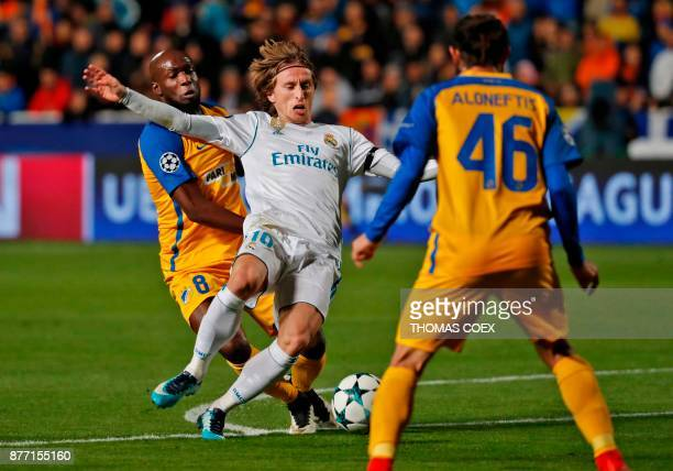 Real Madrid's Luka Modric views for the ball against Apoel's Cypriot midfielder Efstathios Aloneftis during the UEFA Champions League Group H match...