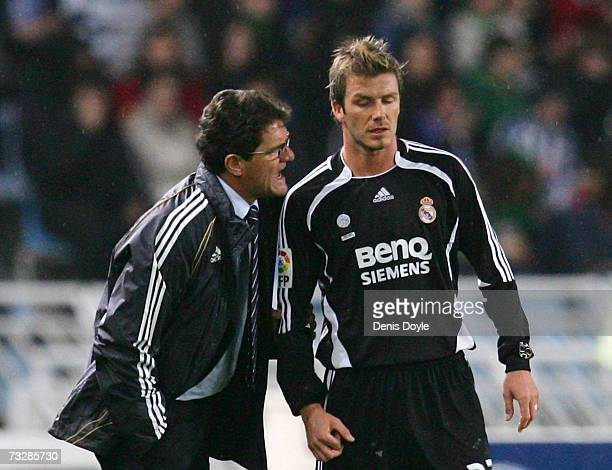 Real Madrid's manager Fabio Capello instructs David Beckham during the La Liga match between Real Sociedad and Real Madrid at the Anoeta stadium on...