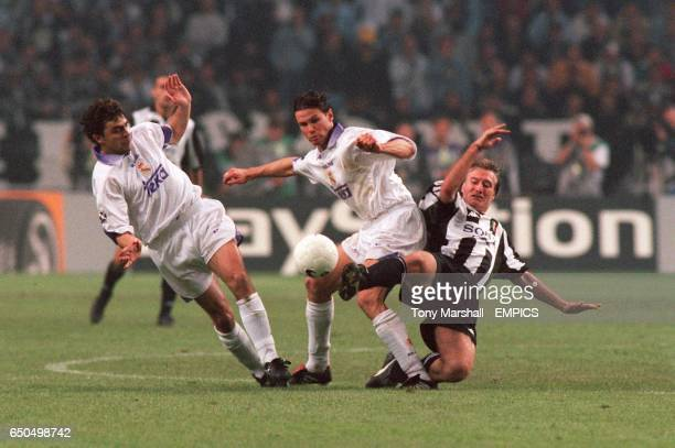 Real Madrid's Manuel Sanchis and Fernando Redondo battle for the ball with Juventus' Didier Deschamps