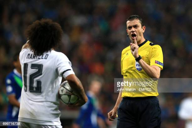 Real Madrid's Marcelo argues with referee Viktor Kassai