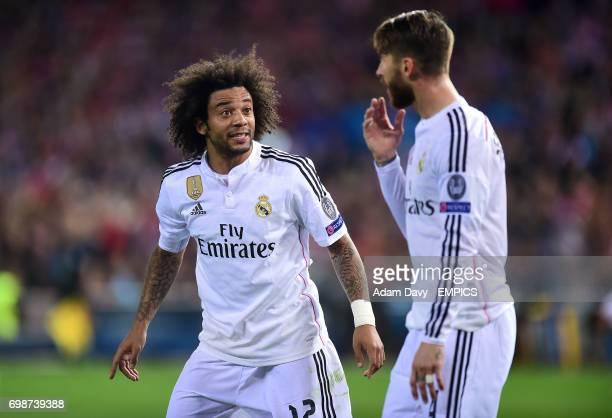 Real Madrid's Marcelo speaks with teammate Sergio Ramos