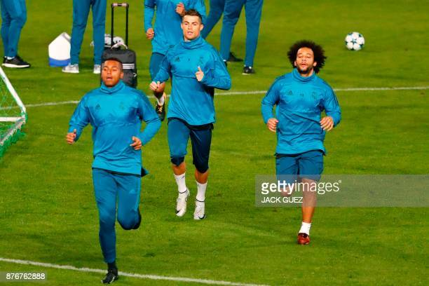 Real Madrid's Marcelo Vieira and Cristiano Ronaldo practise during a training session in the Cypriot capital Nicosia at GSP Stadium on the eve of the...