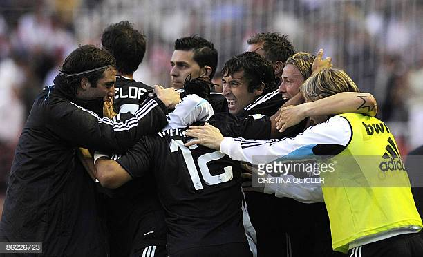 Real Madrid's Marcelo Vieira celebrates after scoring a goal against Sevilla with Jose Maria Guti Christoph Metzeder Raul Gonzalez and Miguel Torres...