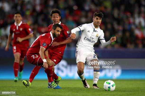 Real Madrid's Marco Asensio and Sevilla's Nicolas Pareja battle for the ball