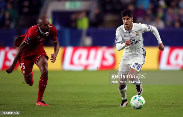 Real Madrid's Marco Asensio and Sevilla's Steven N'Zonzi battle for the ball