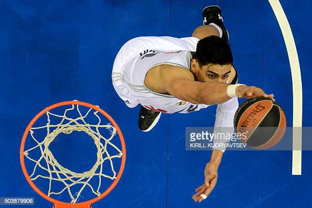 Real Madrid's Mexican center Gustavo Ayon jumps to the basket with the ball during the Euroleague Top 16 group F basketball match between CSKA Moscow...