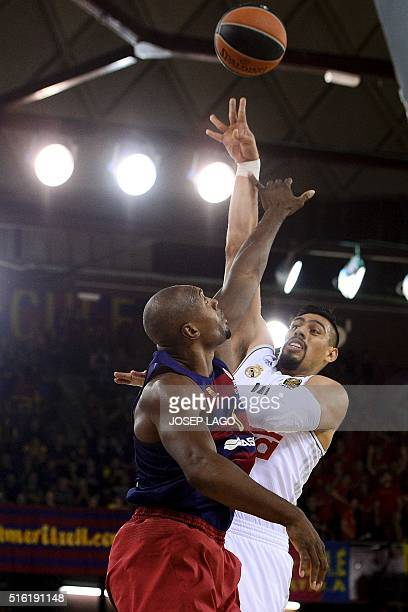 Real Madrid's Mexican centre Gustavo Ayon vies with Barcelona's US guard Joey Dorsey during the Euroleague top 16 group F basketball match FC...