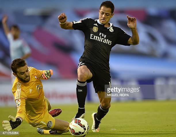 Real Madrid's Mexican forward Javier Hernandez vies with Celta's goalkeeper Sergio Alvarez during the Spanish league football match Celta Vigo vs...