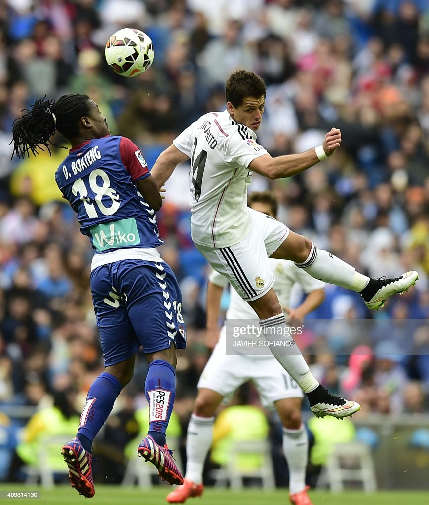 Real Madrid's Mexican forward Javier Hernandez (R) vies with Eibar's Ghanaian midfielder <a gi-track='captionPersonalityLinkClicked' href=/galleries/search?phrase=Derek+Boateng&family=editorial&specificpeople=535783 ng-click='$event.stopPropagation()'>Derek Boateng</a> during the Spanish league football match Real Madrid CF vs SD Eibar at the Santiago Bernabeu stadium in Madrid on April 11, 2015. AFP PHOTO/ JAVIER SORIANO