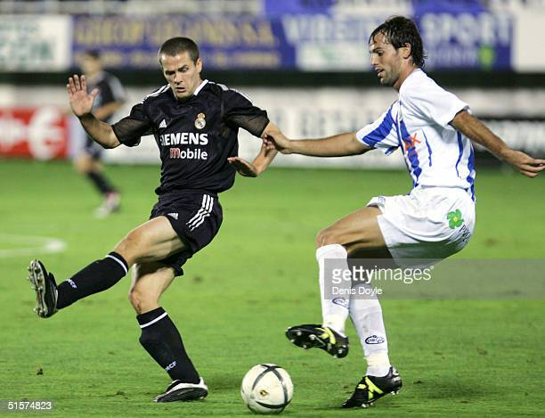 Real Madrids Michael Owen tries to block a clearance by Leganes Ivan Albarran during a Kings Cup soccer match at Leganes Butarque stadium on October...
