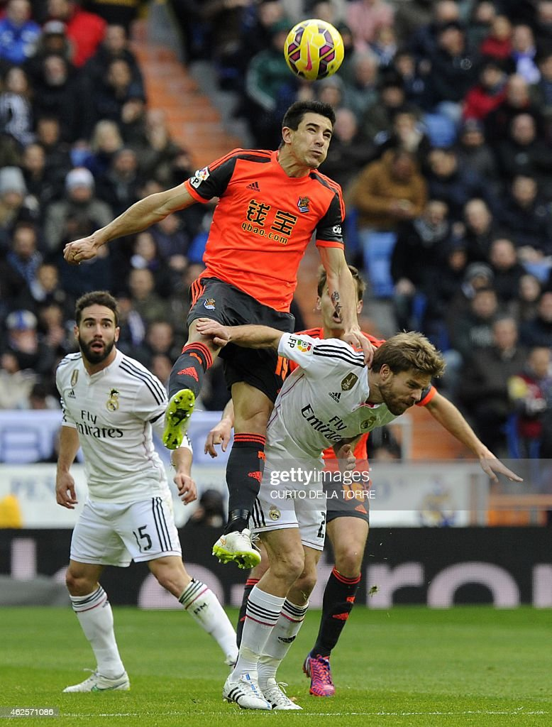 Real Madrid's midfielder <a gi-track='captionPersonalityLinkClicked' href=/galleries/search?phrase=Asier+Illarramendi&family=editorial&specificpeople=9625979 ng-click='$event.stopPropagation()'>Asier Illarramendi</a> (R) vies with Real Sociedad's defender Yuri Berchiche Izeta (C) past Real Madrid's defender <a gi-track='captionPersonalityLinkClicked' href=/galleries/search?phrase=Dani+Carvajal+-+Spanish+Soccer+Defender&family=editorial&specificpeople=7916431 ng-click='$event.stopPropagation()'>Dani Carvajal</a> (L) during the Spanish league football match Real Madrid CF vs Real Sociedad de Futbol at the Santiago Bernabeu stadium in Madrid on January 31, 2015. Real Madrid won 4-1.