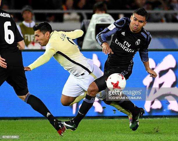 Real Madrid's midfielder Casemiro fights for the ball with Club America's forward Silvio Romero during the Club World Cup semifinal football match...