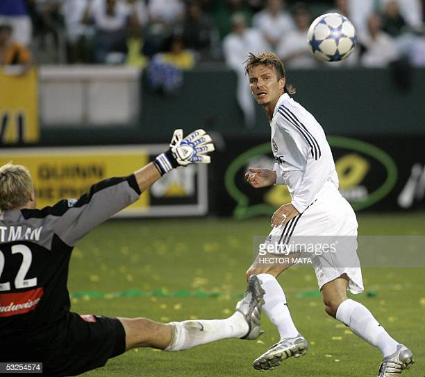 Real Madrid's midfielder David Beckham shoots the ball over Los Angeles Galaxy's goalkeeper Kevin Hartman during the first half of their friendly...