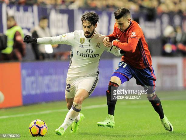 Real Madrid's midfielder Francisco Roman vies with Osasuna's midfielder Alex Berenguer during the Spanish league football match CA Osasuna vs Real...