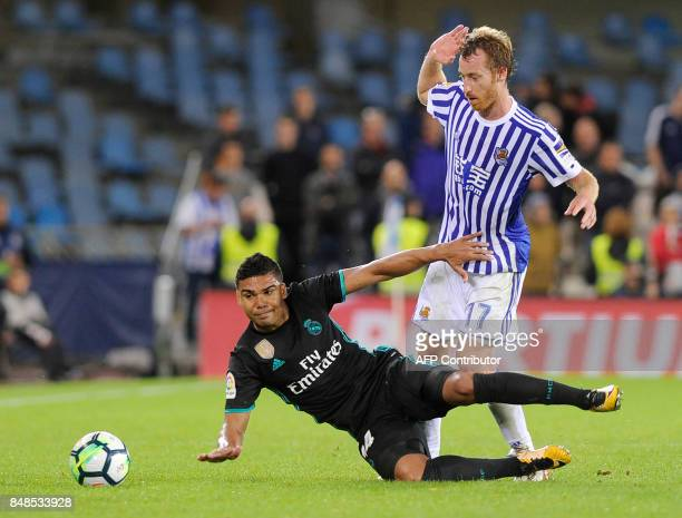 Real Madrid's midfielder from Brazil Casemiro vies with Real Sociedad's midfielder from Spain David Zurutuza during the Spanish league football match...