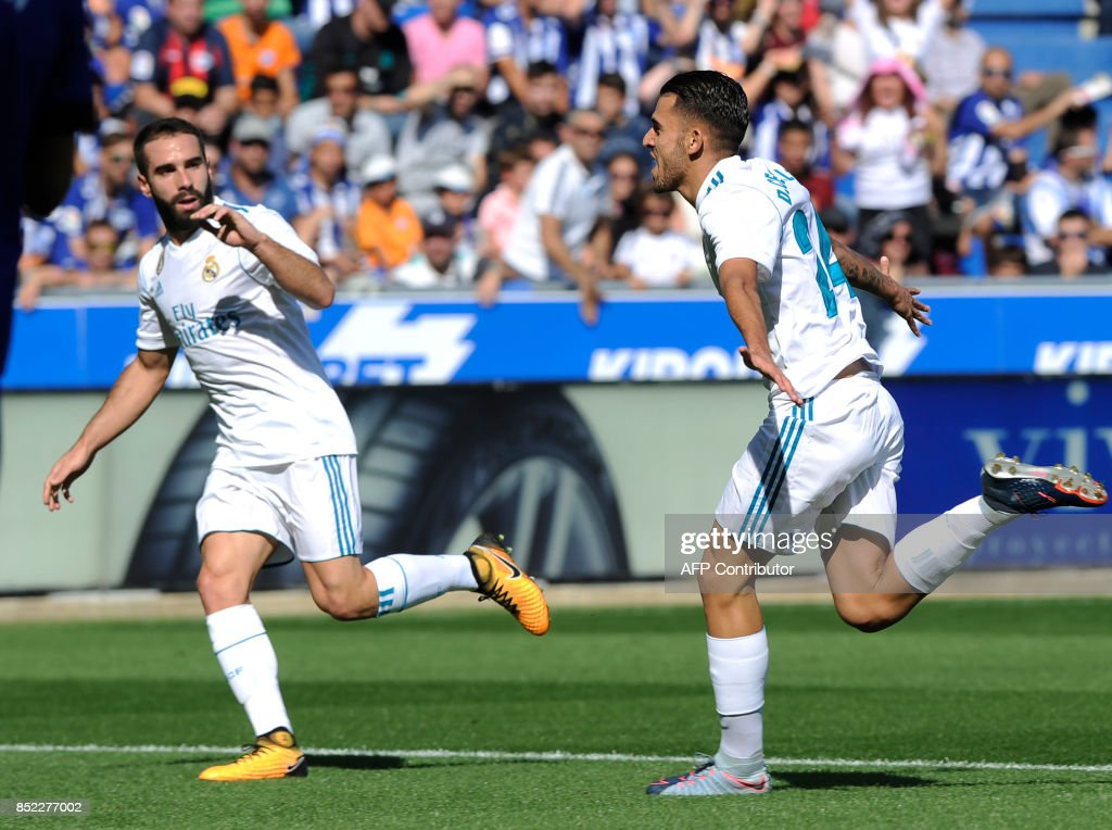 Real Madrid's midfielder from Spain Daniel Ceballos (R) celebrates after scoring his team's first goal beside Real Madrid's defender from Spain Dani Carvajal during the Spanish league football match Deportivo Alaves vs Real Madrid CF at the Mendizorroza stadium in Vitoria on September 23, 2017. /