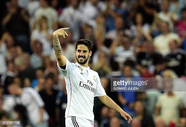 Real Madrid's midfielder Isco celebrates after scoring during the Spanish league football match Real Madrid CF vs Valencia CF at the Santiago...