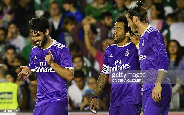 Real Madrid's midfielder Isco celebrates after scoring past Real Madrid's Brazilian defender Marcelo and Real Madrid's Welsh forward Gareth Bale...