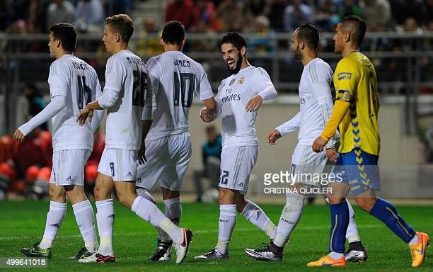 Real Madrid's midfielder Isco celebrates after scoring with Real Madrid's Colombian midfielder James Rodriguez during the Spanish Copa del Rey...