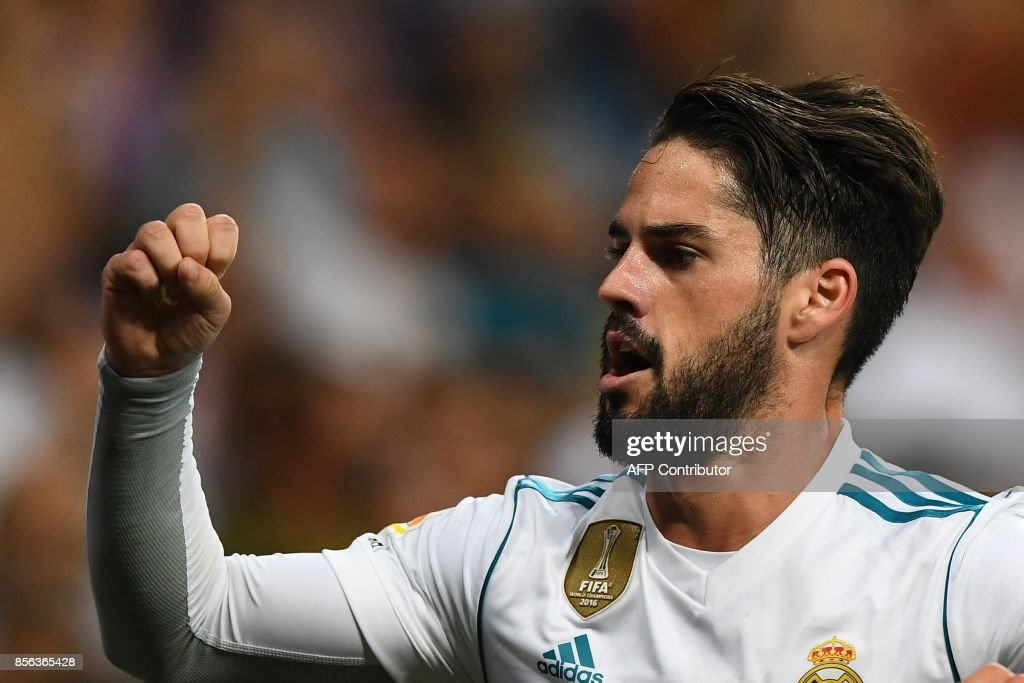 Real Madrid's midfielder Isco celebrates his second goal during the Spanish league football match Real Madrid CF vs RCD Espanyol at the Santiago Bernabeu stadium in Madrid on October 1, 2017. /