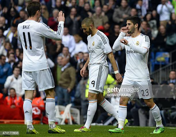 Real Madrid's midfielder Isco celebrates with Real Madrid's French forward Karim Benzema and Real Madrid's Welsh striker Gareth Bale after scoring...